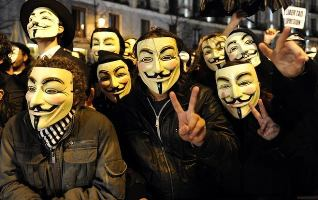 Members of an anonymous group protest during Spain's film Goya Awards ceremony at Teatro Real in Madrid, on February 13, 2011.  AFP PHOTO / JAVIER SORIANO.