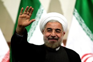 Iranian president-elect Hassan Rowhani waves as he attends a press conference in Tehran on June 17, 2013. Rowhani expressed hope that Iran can reach a new agreement with major powers over its disputed nuclear programme, saying a deal should be reached through more transparency and mutual trust. AFP PHOTO/BEHROUZ MEHRI